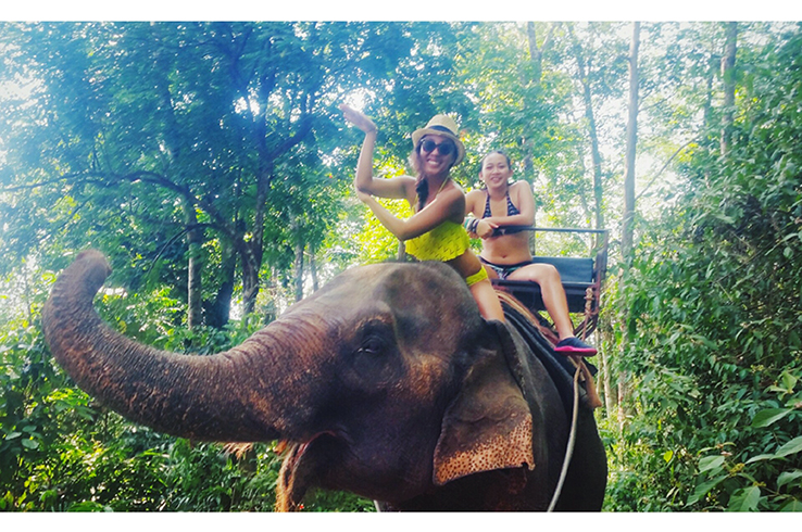 Cris with sister Ari riding the elephants