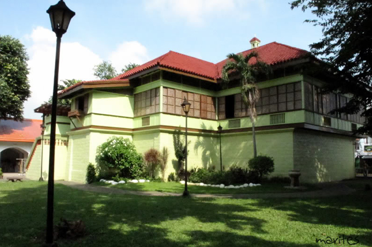 Jose Rizal's home is now painted green, but of course back then it had a limestone-creme color.